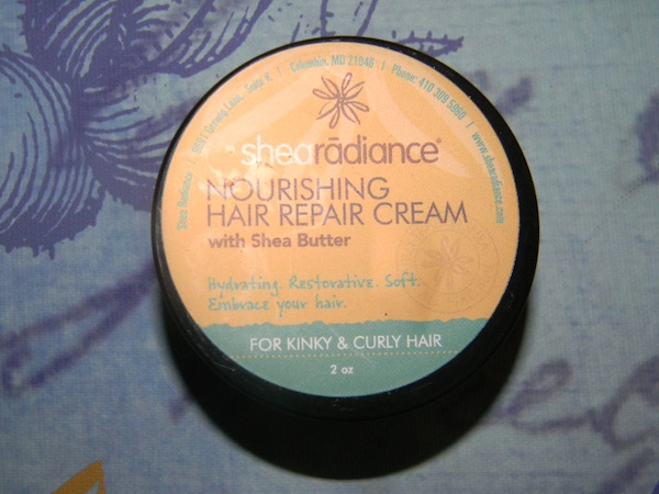 Contents inside of July 2012 curlbox beauty subscription program: shea radiance nourishing hair repair cream