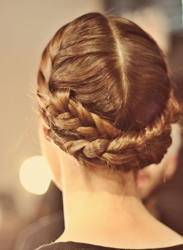 Backstage at Christian Siriano at Mercedes Benz Fashion FW 2013. Beauty by Aveda. Hair in braids