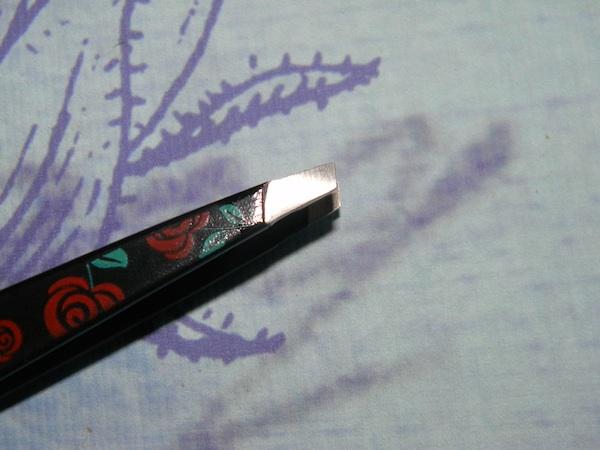 Tweezerman rose tweezer close up.